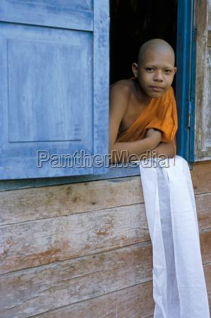 novice monk buddhist monastery at angkor