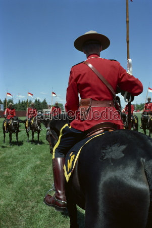 mounties on horseback during roll call