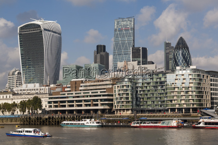 city skyline and river thames london