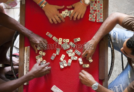 overhead view of four people playing