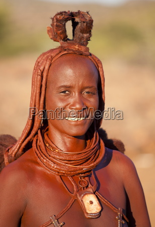 himba woman wearing traditional leather clothing