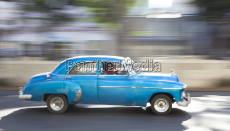 panned shot of old american car