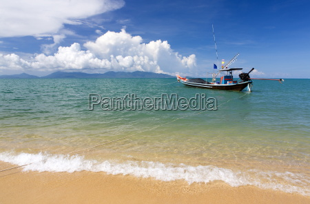traditional long tailed fishing boat moored