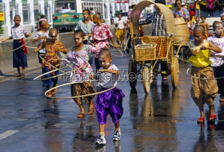 children playing and parading in streets