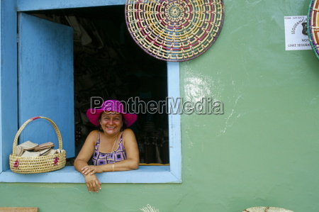 hat seller at the window of