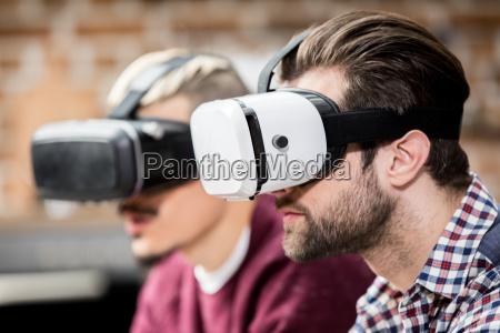men in virtual reality glasses