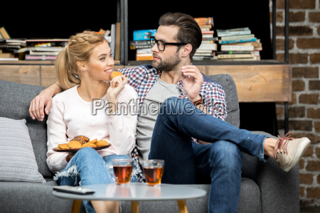 couple drinking tea with biscuits