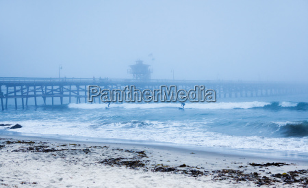 san clemente pier with surfers on