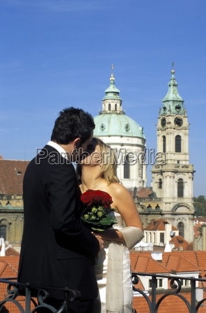 portrait of a couple kissing after