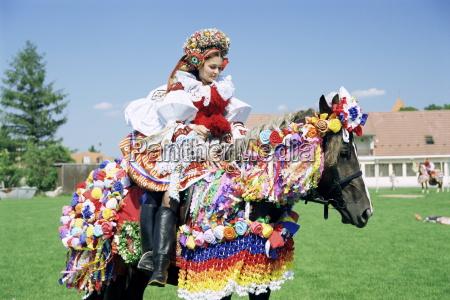 young woman wearing folk dress on
