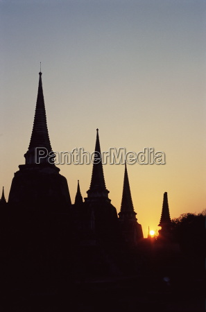 chedis pagodas stupas in silhouette at