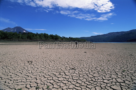 backpacker walking across dried up lake