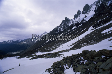 backpacker climbing pass to get to