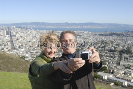 married couple take photo of themselves