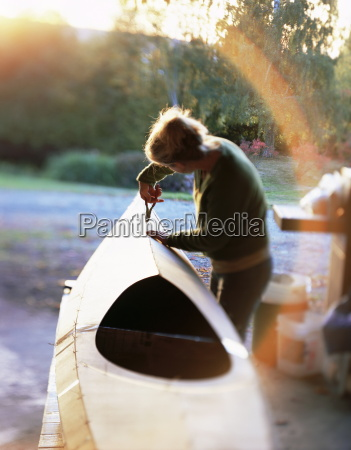 boat builder working on a stich