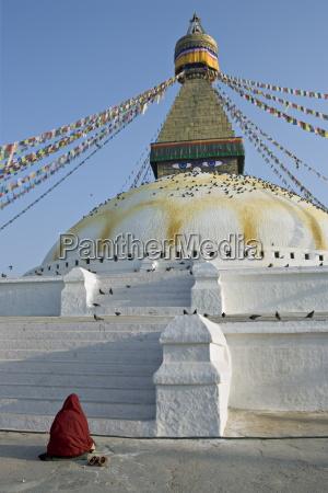 monk in meditative prayer before the