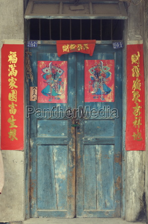 door with chinese art and characters