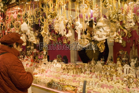 woman looking at christmas decorations at
