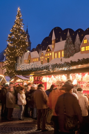 christmas market with decorated stall people