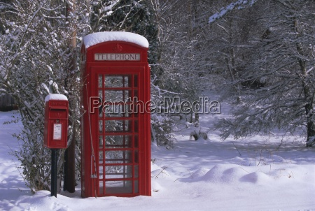 red letterbox and telephone box in