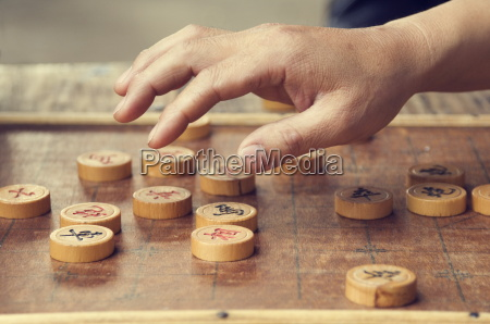 chinese chess board and players hand