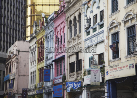 traditional chinese shophouses and modern skyscraper