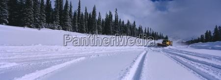 snow plough rocky mountains alberta canada