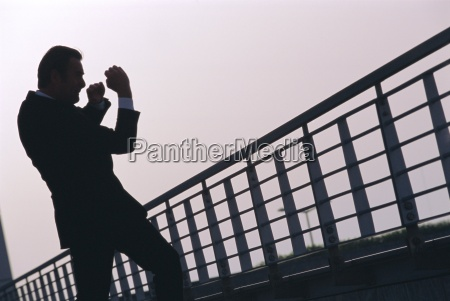 a business man outdoors shadow boxing