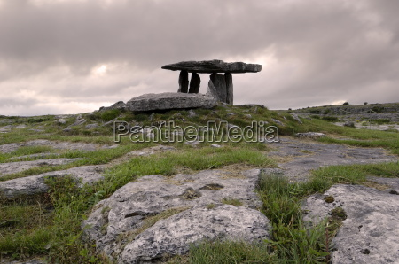 moody sky over poulnabrone dolmen portal