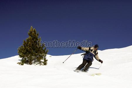 a skier carves a long turn