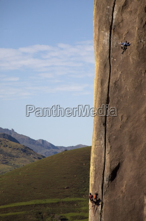 two climbers tackle a difficult route
