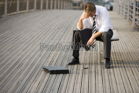 depressed man on bridge paris france