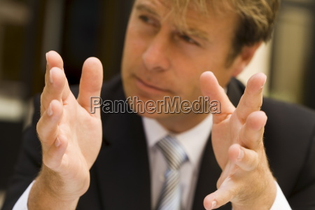 business man using hand gestures