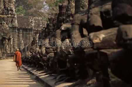 buddhist monk approaching south gate angkor