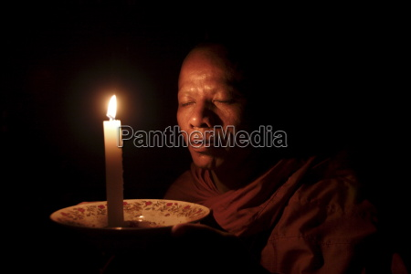 a monk meditates at a buddhist