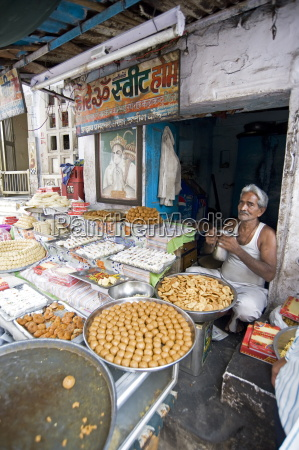 diwali sweet stall with stallholder and