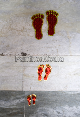 decorative footsteps indicating a welcome into