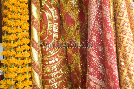 red and gold tinselled cloths for