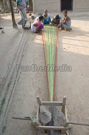 village women in communal area preparing
