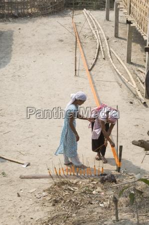 assamese tribal village women spinning sari