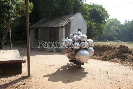 heavily laden metal pot seller on