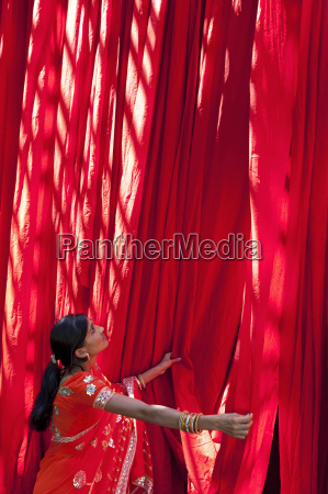 woman in sari checking the quality