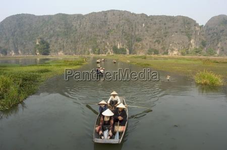 boat on river limestone mountain scenery