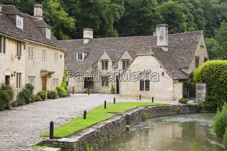 houses near the brook castle combe