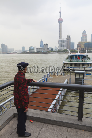 a man watching ferries crossing the