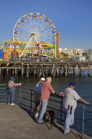 people fishing on santa monica pier