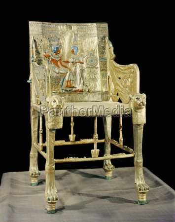 the gilt throne the back decorated
