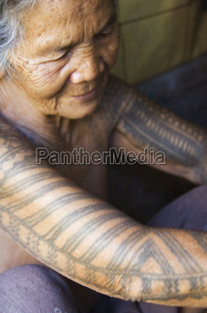 old woman with traditional tattoo on