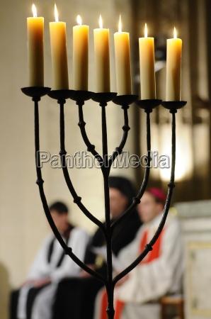 menora in catholic church lit during