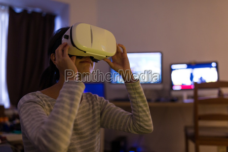 woman using virtual reality device